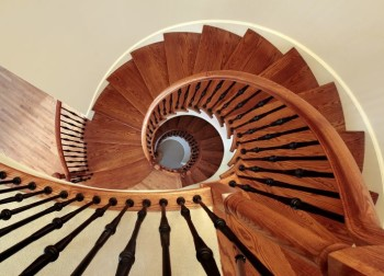 Spiral staircase in luxury home with black railing